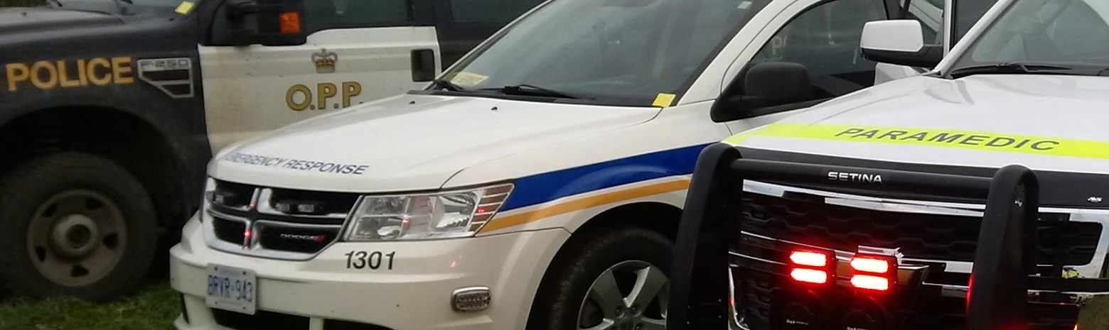 Close up of OPP Emergency services and paramedic vehicles