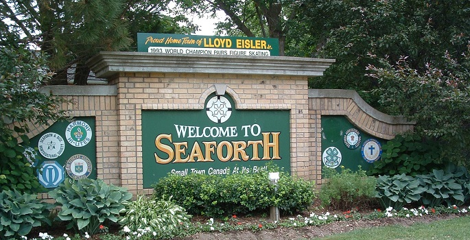 Welcome to Seaforth Sign , brick wall with flowers