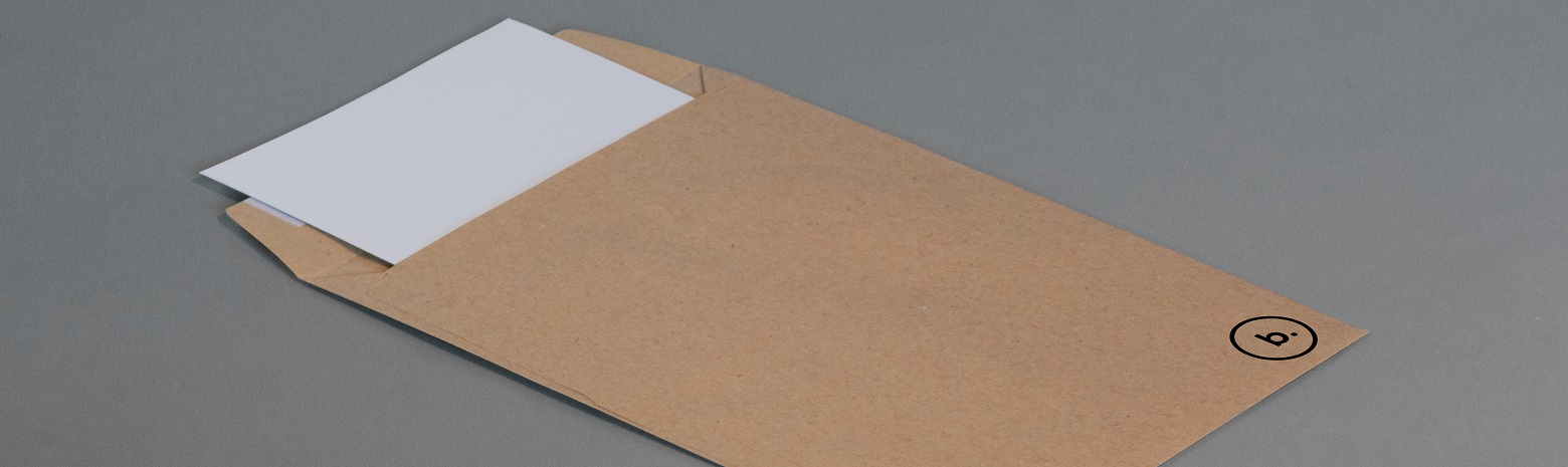 Brown envelope with white paper inserted into it
